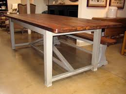picturesque brown reclaimed teak wood farmhouse table and brushed