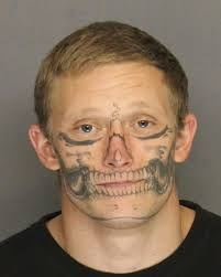 cops nab escaped inmate with face tattoo after weeks on run