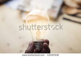 business women hand holding light bulb stock photo 562155895