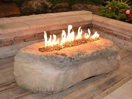 How To Lite A Fire Pit - gas fire pit in a boulder stone fire pit table