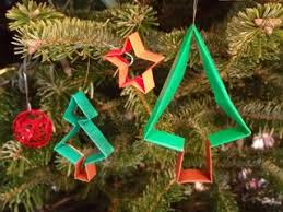 trees decorated with origami ornaments around