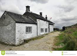 english countryside landscape old house clouds stock photos