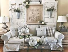 living room using chippy old doors behind couch farmhouse decor
