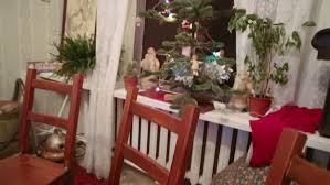Christmas Table Decoration Next by Decorations With Lighted Glasses Fireplace And Firewood Next To A