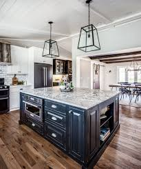 kitchen with black island and white cabinets classically clean a black white kitchen masterpiece