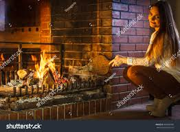woman fireplace making fire bellows young stock photo 498438784