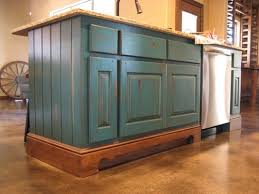 teal kitchen island with crackle distressing and glaze to