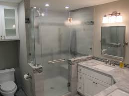 glass shower room with sliding glass door and silver steel frame