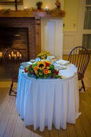 Sunflower Centerpiece Rustic Sweetheart Table With Fall Sunflower Centerpiece And Fireplace