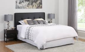 interior grey leather headboard connected by cream bed sheet on