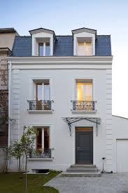 Classical House Design White Brick French House With Dark Roof Tile And Black Wooden