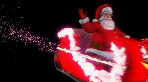 santa claus on his sleigh with reindeer flying left to right