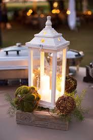 white lantern centerpieces rustic white lantern green moss wedding centerpieces