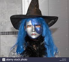 blue witch costume witch with blue hair halloween party london uk europe stock photo