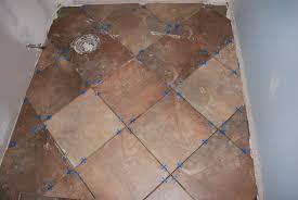 half bath floor tiling guinness backyard