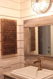 farm house style bathroom with ship lap walls weathered wood