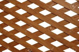 wooden trellis with rhomb shaped holes stock photo picture and