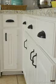 white kitchen cabinets with glass cup pulls rubbed bronze cup pull 64mm 3