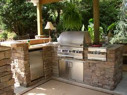 i would love an outdoor kitchen with barbecue range and fridge