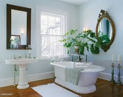 bathroom with freestanding tub and sink stock photo getty images