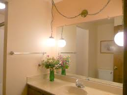 How To Hang A Large Bathroom Mirror - updating bathroom vanity lighting tips for home sellers home