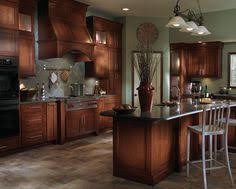 cherry cabinets are topped with black granite counters the