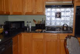 ideas for decorating kitchen interior tin backsplash with varnished wood kitchen cabinet and