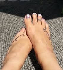 daughters name and birthdate tattooed on my foot i prob wouldn