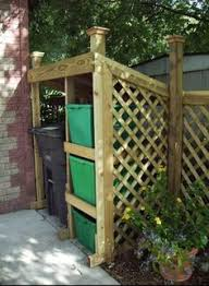 Backyard Garbage Cans by Idea For Hiding The Garbage Cans Outside Chuck U0027s Wall
