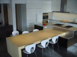 modern wood kitchen table blue green tiles backsplash white french