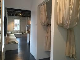 yoga studio reception white bricks simple dressing rooms grey