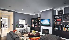 recessed lighting over fireplace black bookshelf design with tv on grey wall paint color above