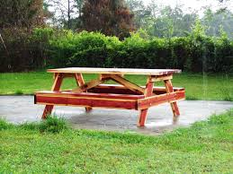 Round Redwood Picnic Table by Picnic Tables