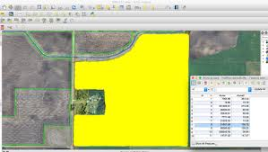 area is calculating wrong using area in field calculator qgis