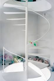 futuristic interior design simple spiral staircase with metalic white painted and floating