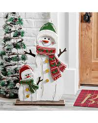 great deal on wooden snowman and snowkid outdoor statue