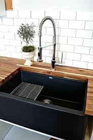 granite composite farmhouse sink our black granite composite sink contrasts beautifully in the solid