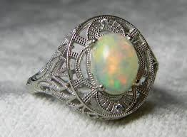 opal engagement ring diamond halo opal engagement ring art deco