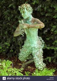 a garden statue of pan the greek god of shepherds and music rhs