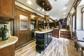 5th Wheel With Living Room In Front   the latest trend in fifth wheels brings the lounge upstairs www
