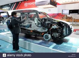 the toyota a cross section of the toyota rav4 ev is on display on the second