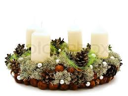 christmas handmade garland with candles and natural decorations