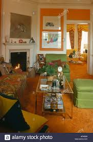 orange shagpile carpet in sixties living room with green chairs