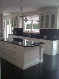 Kitchens With White Cabinets And Black Countertops by Dark Granite Adds A Touch Of Luxury The Hard Surface Is Extremely