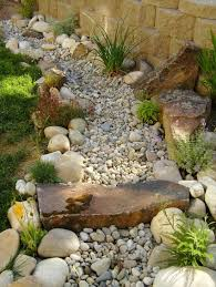 dry creek bed needs ceramic fish planters filled with cement