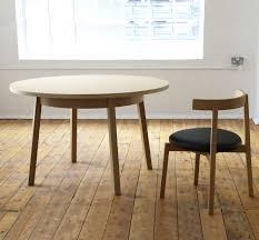 modern round wood dining table oki nami dining table by nazanin kamali case furniture