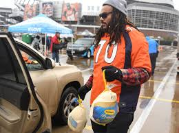 broncos players spend day helping those in need
