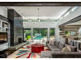 neutral colors loft open floor plan dark wall mount tv drum coffee