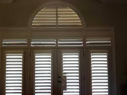 shutters arched transom wood white living room door jpg