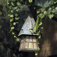 whimsical european country front porch exterior ceiling light